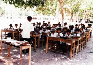 Children study outside before their school is built