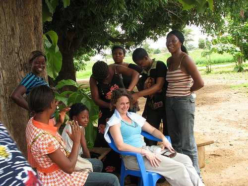 Wendy has her hair braided in Wiaga, Ghana