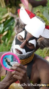 Man with mirror getting ready for Mt Hagen Show