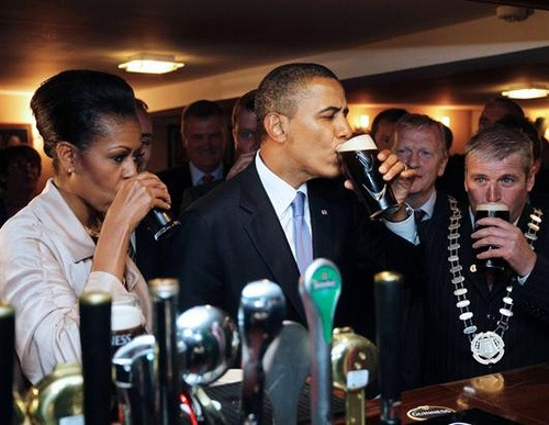 Michelle and Barack Obama enjoy a drink at Ollie Hayes pub
