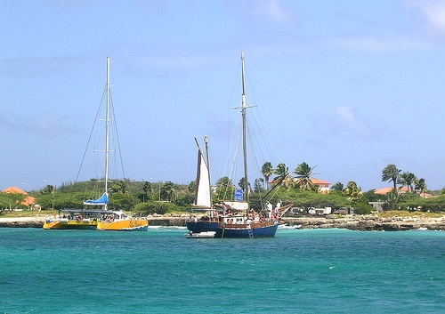 Beachfront Homes and Boats in Aruba