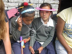 Children trying the ipod in Nepal
