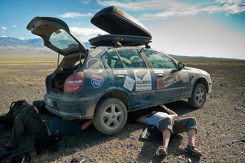 Muffler repair in Mongolia on the Mongol Rally Photo: Sherry Ott