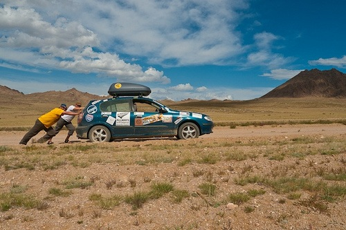 Pushing a car in Mongolia on the Mongol Rally Photo: Sherry Ott