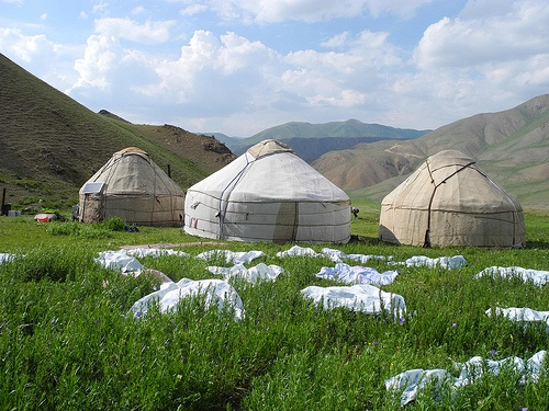 Yurts, sheep and mountains, represent the fabric of Kyrgyzstan Photo: Globein.com