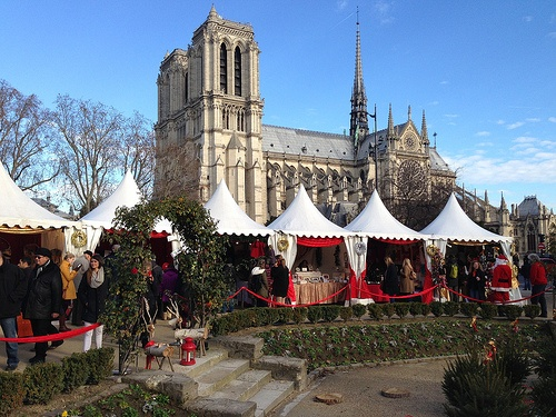 Christmas market in front of Notre Dame in Paris Photo: Heatheronhertravels.com