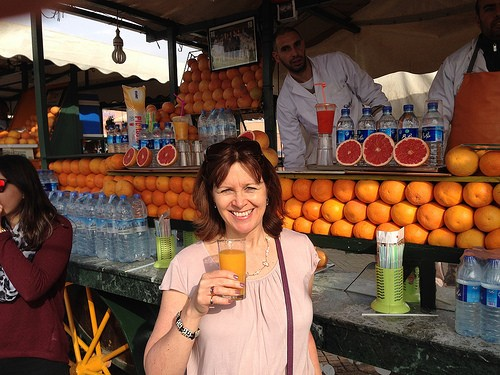 Heather tries a freshly squeezed orange juice in Jemaa El Fnaa, Marrakech Photo: Heatheronhertravels.com
