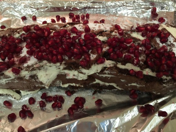 Chocolate roulade with pomegranate seeds for Christmas