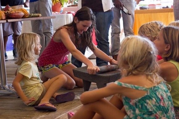 Children learn about making chocolate at the Grenada Chocolate Festival