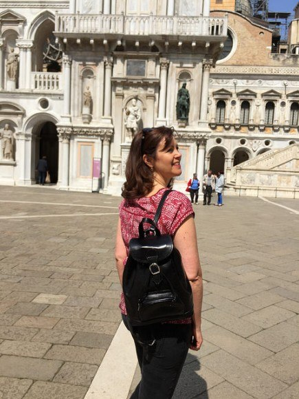 Heather wearing the Sparano leather backpack from Maxwell Scott Bags in Venice - Doge's Palace Photo: Heatheronhertravels.com