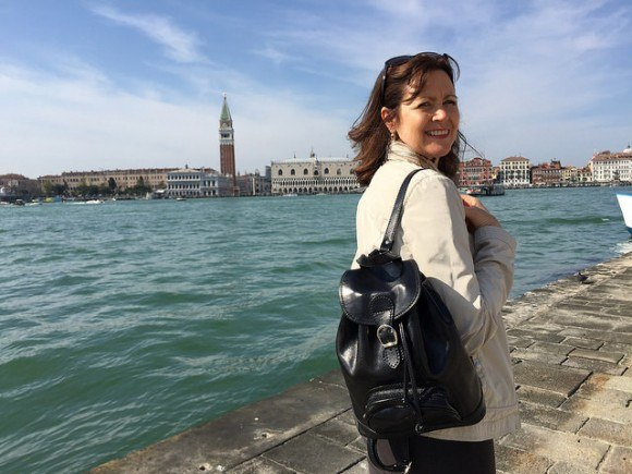 Heather wearing the Sparano leather backpack from Maxwell Scott Bags in Venice - San Georgio Photo: Heatheronhertravels.com