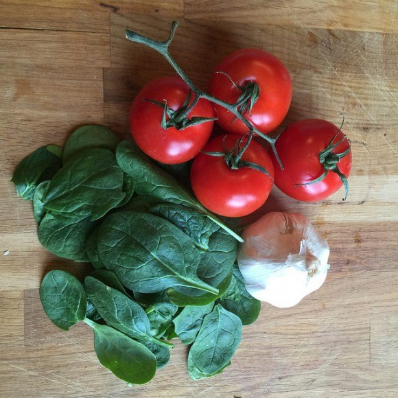 Fresh tomatoes, garlic and spinach from The Traveller's Table Photo: Heatheronhertravels.com