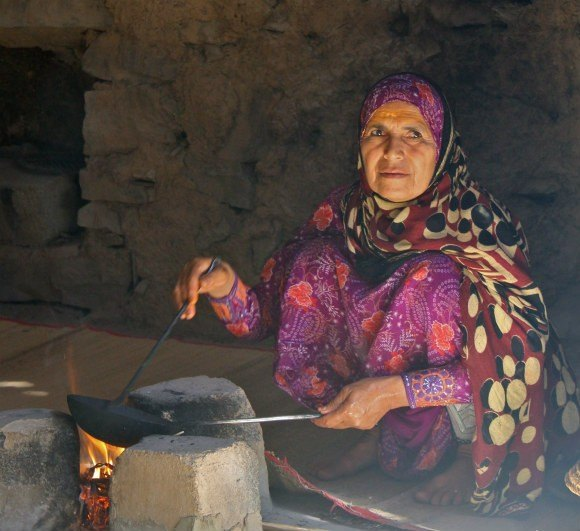 Woman roasting coffee near Bahla in Oman Photo: AudleyTravel.com