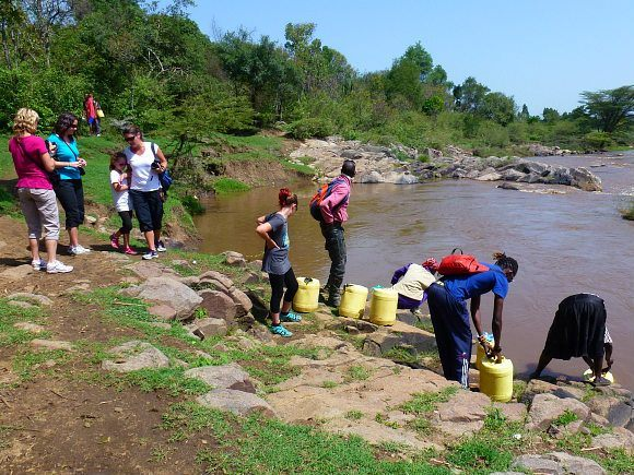Collecting water from the river in Kenya Photo: Audley Travel