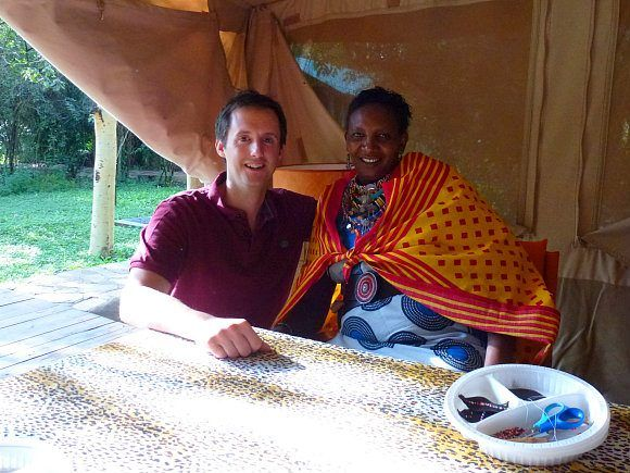 Mark with Mama Joyce and beads Photo: Audley Travel