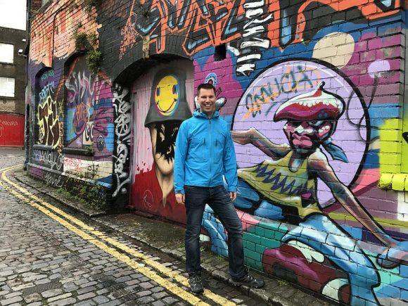 Erik with Street art on Stokes Croft